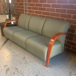 Green Couch with Wooden Armrests